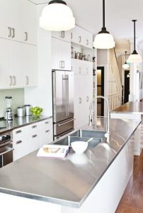 Stainless steel counter tops are durable and easy to clean.