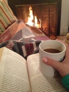 snuggle under a blanket with a good book